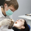 Как быть, если болит зуб под коронкой